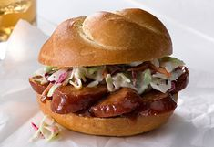 A creamy blend of mayo, BBQ sauce and honey mustard makes a tasty Southern-style condiment for this coleslaw-topped sausage sandwich.