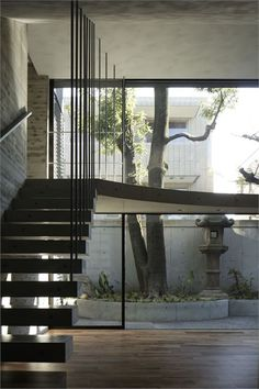 Breeze House by Artechnic - glass wall and free-floating walkway brings the outdoor space closer to the indoor