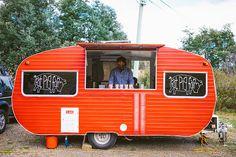 "Mark Evans' ""Fat Pig Farm"" caravan sells organic German-style hot dogs in Tasmania."
