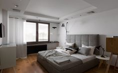 Subway tiled bedroom with warm woods, cool greys, and iron details. Apartment with the Birds by Olena Yudina