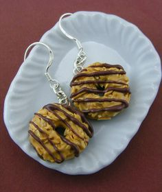 Girl scout cookie earrings by miniaturist Shay Aaron