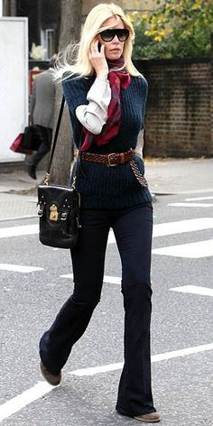 Claudia Schiffer - high neck line, high waist belted with flared pants - gives one a LONG body