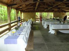Picnic tables set for a wedding reception at picnic shelter at Umstead State Park