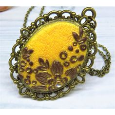 Sunflower yellow filigree pendant with floral applique handmade with... (€12) ❤ liked on Polyvore featuring jewelry, pendants, pendant jewelry, brown pendant, filigree jewelry, handcrafted pendant and brown jewelry