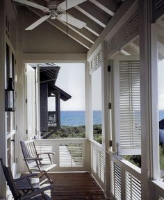 Shutter wrapped porch by Bobby McAlpine; http://aesthetically-thinking.blogspot.com/2011/01/silently-shuttered.html