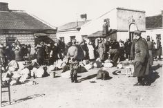 The Jews were rounded up from their homes by German policemen and marched to a collection point. Wloclawek, Poland, 22/04/1942, Deportation of Jews to Chelmno by German policemen.