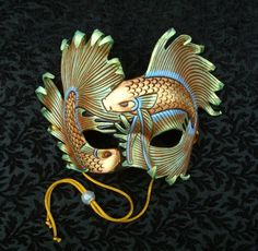 Iridescent Fighting Fish ...handmade original leather art mask by merimask. #masks #venetianmasks #masquerade http://www.pinterest.com/TheHitman14/art-venetian-masks-%2B/
