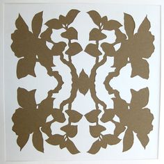 White paper cut and put over brown kraft paper.