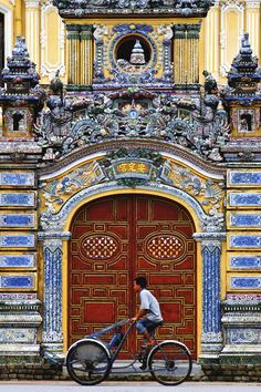 """A picture of the main gate of An Định Palace - King Bảo Đại's private residence home during his early years as the Crown Prince. The palace itself was built in comtemporary European architect and elaboratedly decorated with lavish wall paintings and motifs. The main gate however remains a traditional Vietnamese style with the signature """"two dragons battling for a pearl"""" on top. China Trip, China Travel, Hue Vietnam, Beautiful Vietnam, Main Gate, Virtual Travel, Vernacular Architecture, Wall Paintings, Great Hotel"""