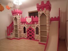 Pretty pink princess castle with staircase and slide. This stunning bed with a bed on the top and play den on the bottom is a truly magical bed to inspire any princess's imagination.