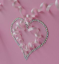 Large 12X24 canvas with two dancing ballerinas and rhinestone heart. Canvas backgrounds and ballerina silhouettes are painted with acrylic paint. Dancers are decorated with tulle skirts, silk ribbons and rhinestones. Large rhinestone heart is a vocal point of this girly canvas art; made