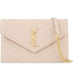 SAINT LAURENT - Monogram quilted leather envelope clutch | Selfridges.com