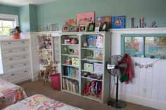 what an adorable little shared bedroom. everything in it is designed to grow with the girls. :-)