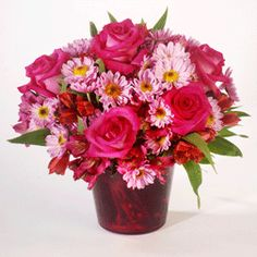 PINK SENSATION:  Roses, Alstroemeria and Daisy Poms in shades of pink are designed in this glass cache vase.  #MatlackFlorist
