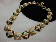 This is a stunning signed Anne Klein multi colored enameled necklace. It has purple, emerald green, ruby red, sapphire blue with byzantine royal styled round cross and square links. Stunning with faux pearl cabochons and brushed gold filigree links. Truly stunning and made with great detail and design. In wonderful condition. I believe from the 80's. Bold statement piece! Ready to wear. Your going to love it!