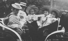 Grand Duchesses Anastasia, Maria, Olga, and Tatiana on a carriage ride with Ms. Eagar (holding Anastasia) and another nanny, 1901. Full size