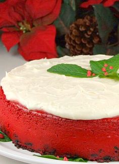 Red Velvet Cheesecake -- We know what we're having this year at our holiday party! | #Recipe by recipegirl.com