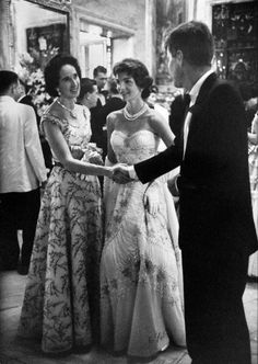 Mrs John R Drexel III shaking hands with the Kennedys at the Tiffany Ball in Newport, 1957. Noreen, who summered with her husband at Stonor Lodge, was a prominent socialite in Newport and Palm Beach. She was an active philanthropist of the Newport Hospital and Birthing Center. For the ball, Noreen had 5 hairdressers fly up from New York City to do her and her family's hair for the event. Mrs Drexel was so formal that her hair always went up at 5 PM and at 6PM jewelry was put on.