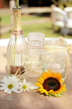 Bright and sunny mason jar and wine bottle centerpieces!