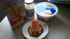 """My fabulous co-worker developed and did this with our kiddos. Its a volcano snack b/c we learned all about them! Chocolate pudding for """"earth"""", then up-side-down ice cream cone for """"volcano"""", add whipped topping with a drop or two for orange food coloring for the texture, then the marshmellow colored red for the """"lava"""". The kids LOVED them. :)"""