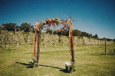 Australian Apple Orchard Wedding: Lauren + Glenn - gorgeous!  i'd change the ribbons to match our colors better and call it a day!
