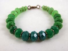 The green beads create a gradient effect in the Gooseberry bracelet featuring Bead Gallery beads available at @michaelsstores and designed by @missmollys of Crafting a Life in Indiana