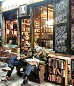Book Store, Paris.... I think I love how unpretentious it looks. I feel its for book lovers and its in PARIS!