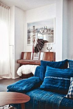 I'm mesmerized by the thoughtful use of indigo in this space.  Warm wood & soft creams and textures lay the perfect base for a rich indigo color.