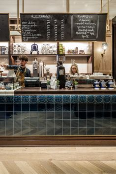 Burr & Co Cafe Edinburgh, Scotland. Beautiful green / blue tiles on bar from with brass edge detail. Gorgeous oak panelling and cute little nooks. Stunning Cafe. A must see.