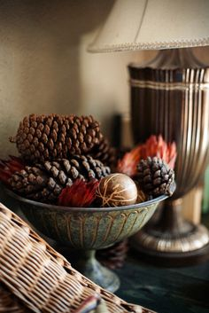 like the bowl - could use pine cones, little pumpkins, and some of my decorative wooden colored balls from Hobby Lobby