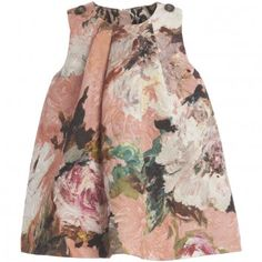 Dolce & Gabbana girls thick textured shift dress with silk that adds a luxurious feel. With beautiful pastel-coloured flowers it is fully lined with the iconic 'ocelot print' fabric and fastens at the back with a zip.