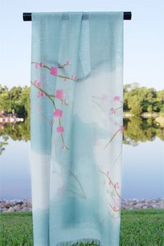 This best-selling #scarf, adorned with a delicate cherry blossom motif, is perfect for cool #summer evenings. #sakura #morikami