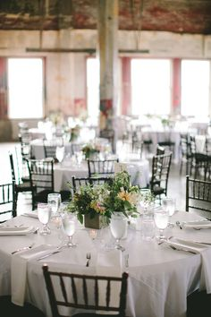 industrial wedding reception, photo by Steven Michael Photography http://ruffledblog.com/kansas-city-loft-wedding #weddingideas #weddingreception