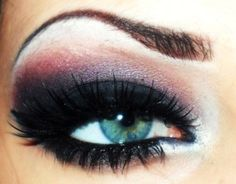 Dramatic black smokey eyes with a hint of pink and full lashes! L♥Ve it!