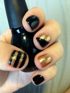 black and gold nail polish art