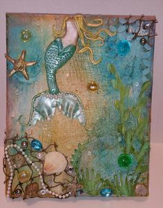 "MERMAID CANVAS Hand Crafted Mermaid. Mixed Media Canvas, stretched 8"" x 10"". $50. mermaid tail and hair are hand sculpted with clay. Various jewels and sea shell embellishments. Custom orders welcomed! Prices will vary depending on size and embellishments."