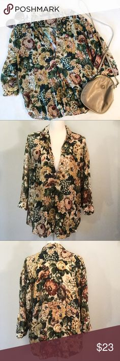 "Zara Woman Deep V floral tunic top Zara Woman Deep V floral tunic top. Classic, colorful all over floral print. Collared, deep v neckline. Quarter length button sleeves. Oversized, flowy, lightweight tunic style. 100% viscose. Size large. EUC, excellent used condition. Measurements taken laid flat. 25"" bust, 29"" length. Zara Tops Blouses"