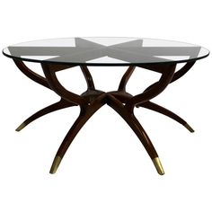Mid-Century Modern Collapsible Spider Leg Coffee Table | From a unique collection of antique and modern coffee and cocktail tables at https://www.1stdibs.com/furniture/tables/coffee-tables-cocktail-tables/