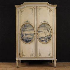 A Louis XVI style Italian wardrobe with beautiful painted floral and scenic decorations. From DC member, Parino.
