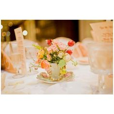 Vintage teacup centerpiece « Weddingbee Gallery found on Polyvore