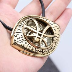 Feel the strength and powers of the Sorcerer Supreme, Doctor Strange, by having this inspirational Eye of Agamotto necklace. Benedict Cumberbatch wears this necklace as Doctor Stephen Strange in the s