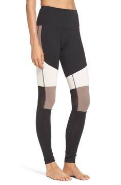Neutral color blocking and a high waist flatter the figure in high-performance leggings inset with mesh to manage body heat.