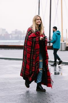 """They're calling this """"The Best of NYFW Street Style FW18"""" and it's just that old blanket in the linen closet you never wear, bf jeans, and your old doc martens. #fashionfeels #comfort #style"""