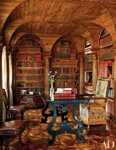 In the Italian town of Oderzo, near Venice, Villa Bucciol, the home of businessman Lorenzo Bucciol and his family, has been transformed by Roberto Peregalli and Laura Sartori Rimini of the Milan-based design firm Studio Peregalli. The library features oak paneling and columned arches; the table is 17th-century Tuscan, and the embossed-leather chairs are Louis XVI.