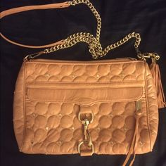 Rebecca Minkoff Quilted Studded Mac With Tassels Rebecca Minkoff MAC quilted and stuffed bag. Gold hardware. Removable tassels that can be used as a key chain. And longer tassels on the front zipper, two small pockets and larger zipper pocket on the inside. This bag is a light cognac peachy color very cool color can be worn with many colors. Great condition. Detachable chain is 22 inches bag is 12 inches in length and 8 inches by width. Smoke and pet free. Rebecca Minkoff Bags Crossbody Bags