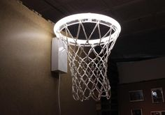 Karl Zahn, Dunk. 2010. -   It's a basketball hoop. It's a light. A blend between the incredible functionality of a basketball hoop and the ironic fragility of a light bulb. Tension results as the viewer suppresses their overwhelming urge to use the basketball hoop as intended with the realization that they cannot.  www.karlzahn.com