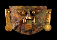 This large Sicán mask is a fine example of using pigments to add to the aura of these highly stylized  funerary items. Sicán masks from the north coast of Peru are some of the largest ancient goldworks known. The carefully hammered flat surfaces were layered with ear and nose dangles, eye stalks, and often painted with sacred red and green pigments, to create a dazzling collage of three-dimensional quality, even creating an acoustic effect.