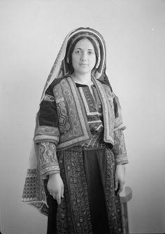 Ramallah-رام الله: Ramallah - A Palestinian woman from Ramallah (Wedad Khuri) in traditional embroidered dress 3 - early 20th c. - (Matso...