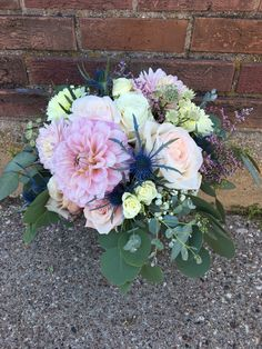 Loved it! Pinned it! A Blooming Envy Design! Wedding Bouquet designed with white and blush roses, white and blush dahlias, astrantia, blue thistle and eucalyptus.