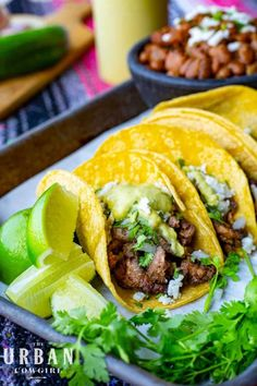 These steak street tacos can be whipped up in 30 minutes or less and are an easy way to whip up beef tacos for your next party, the big game, or a potluck! Get the recipe now on UrbanCowgirlLife.com Tailgating Recipes, Barbecue Recipes, Grilling Recipes, Beef Dishes, Tasty Dishes, Sauce Recipes, Beef Recipes, Mexican Food Recipes, Mexico